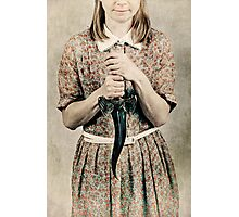 Female holding a curved knife Photographic Print
