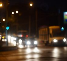 Defocused image of night traffic on city street by vladromensky