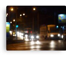 Defocused image of night traffic on city street Canvas Print
