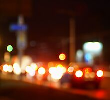 Trucks and cars with headlights was blurred for use as a background by vladromensky