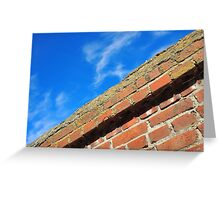 Bottom view on top of the stone wall of bricks against a blue sky Greeting Card