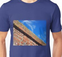 Bottom view on a fragment of an old brick fence Unisex T-Shirt