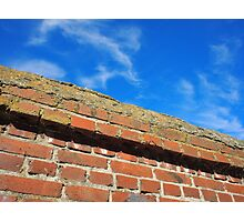 Bottom view on a fragment of red brick fence Photographic Print
