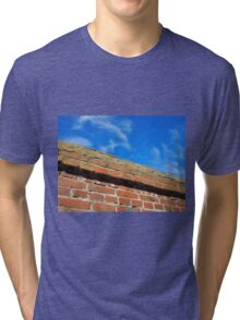 Bottom view on a fragment of red brick fence Tri-blend T-Shirt