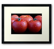 Wet whole tomatos Framed Print
