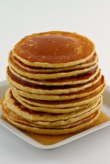 Stack of pancakes with syrup by Gert Lavsen