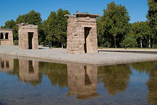 Egyptian temple in Madrid is reflected in surrounding transparent water by Larisa13