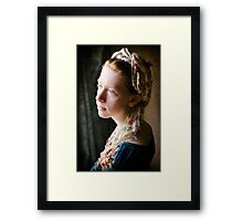 portrait of a young lady by the window Framed Print