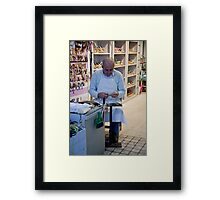 The Sandal Maker Framed Print
