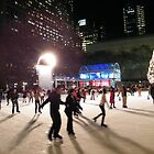 Ice Skating at Night, Bryant Park, New York  by lenspiro