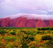 Mighty Uluru Under Storm Cloud by Ronald Rockman