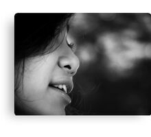 Black and white closeup of the face of a smiling  Canvas Print