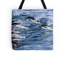 Gentoo penguins (Pygoscelis papua). swimming in the ocean Tote Bag