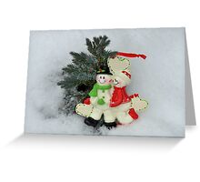 Cute couple with Santa costumes kissing and hugging on Christmas  Greeting Card