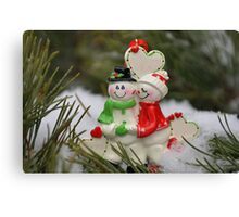 Cute couple with Santa costumes kissing and hugging on Christmas 2 Canvas Print