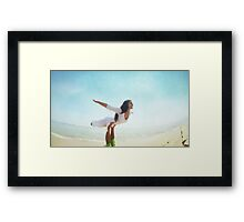 Acroyoga flying in the beach Framed Print
