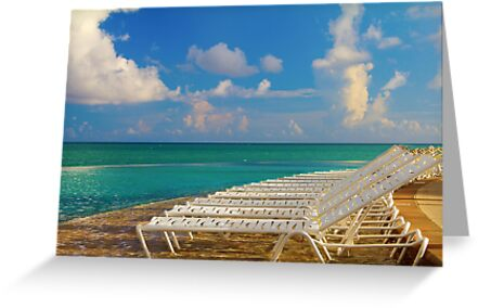 Beach chairs in a tropical pool in the Bahamas by Svetlana Day