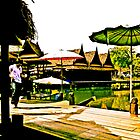 Umbrellas, TH houses, canal, noodle shop, boats and ice-cream in hand... by Kornrawiee