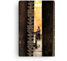 African boy in courtyard Stone Town Canvas Print