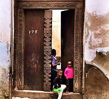 Three African kids Zanzibar by Amyn Nasser