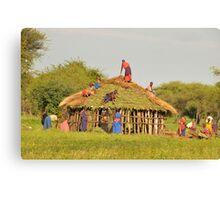 Masai women building a home in Tanzania Canvas Print
