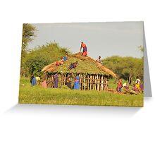 Masai women building a home in Tanzania Greeting Card