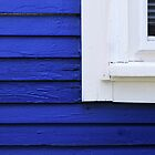 Blue clapboards, white window frame by woodnimages