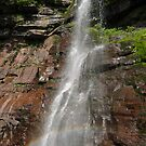 Side view of Lower Kaaterskill falls with rainbow, Upstate New York by Anton Oparin