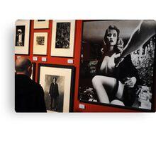 Unknown man looking at Art work of Helmut Newton worth $125.000 Canvas Print