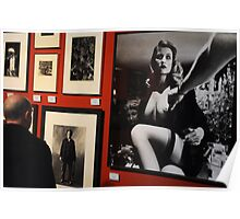 Unknown man looking at Art work of Helmut Newton worth $125.000 Poster