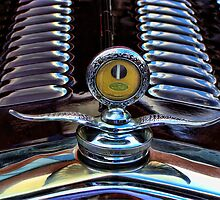 Antique Ford hood emblem by vigor