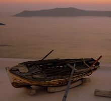 That Boat on the roof in Santorini, sunset by kelliejane