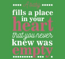A baby fills a place in your heart  Kids Tee