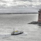 Waves off -Poolbeg Light house by Ferdinand Lucino