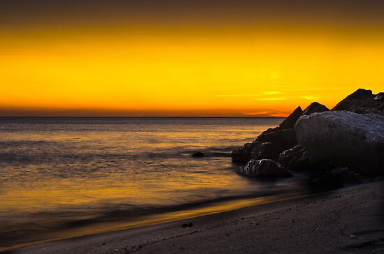 Rocks and Waves at Sunset by Marco Borzacconi