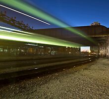 Train makes green streaks of light by Sven Brogren