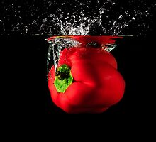 Red Pepper Splash Into Water by Riaan Roux