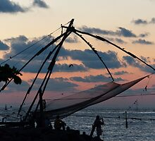 Chinese fishing net at Kochi, India, at dusk. by photograham