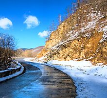 frozen road in the mountains by katta