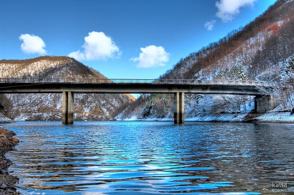 bridge over frozen lake by katta