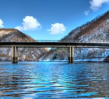 bridge over frozen lake by katta