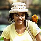 A portrait with a parakeet. by debjyotinayak