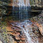 Waterfalls over Rocks by tom j deters