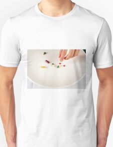 Diet concept - female Teen eats vitamins and pills instead of food  T-Shirt