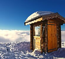 Sunlit Hut Above Clouds in the French Alps by ieatstars