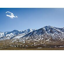 Beautiful snowy Tibetan high mountain landscape with the lonely cloud Photographic Print