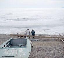 sitting at the edge of lake baikal by offpeaktraveler