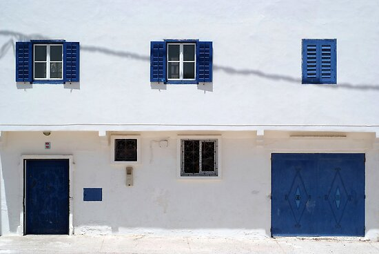 blue doors, blue windows, white walls by offpeaktraveler