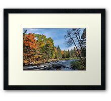 Rich colors of an autumn forest on a stony riverside Framed Print