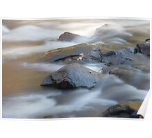 Close up view of a stony riverbed and silver stream Poster